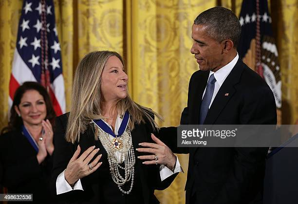 S President Barack Obama presents the Presidential Medal of Freedom to singer Barbra Streisand during an East Room ceremony November 24 2015 at the...