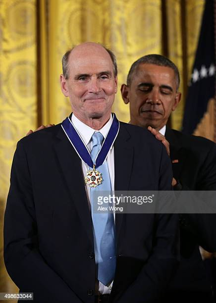 S President Barack Obama presents the Presidential Medal of Freedom to singersongwriter James Taylor during an East Room ceremony November 24 2015 at...