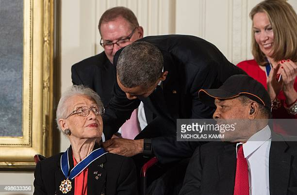 US President Barack Obama presents the Presidential Medal of Freedom to NASA mathematician and physicist Katherine Johnson at the White House in...