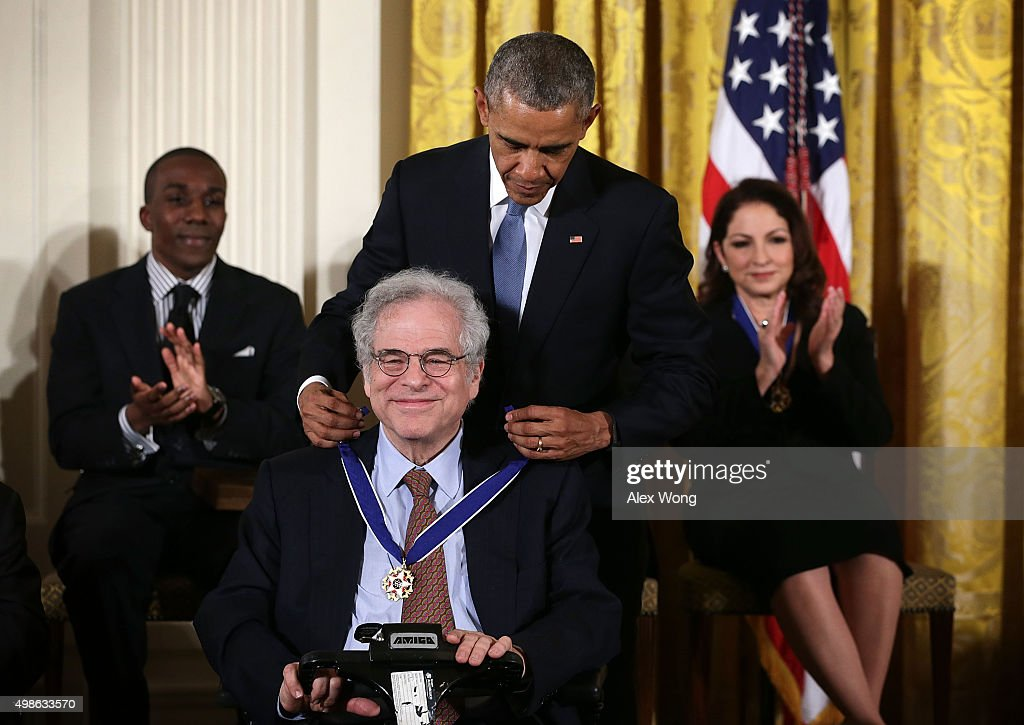 U.S. President <a gi-track='captionPersonalityLinkClicked' href=/galleries/search?phrase=Barack+Obama&family=editorial&specificpeople=203260 ng-click='$event.stopPropagation()'>Barack Obama</a> presents the Presidential Medal of Freedom to conductor <a gi-track='captionPersonalityLinkClicked' href=/galleries/search?phrase=Itzhak+Perlman&family=editorial&specificpeople=593397 ng-click='$event.stopPropagation()'>Itzhak Perlman</a> during an East Room ceremony November 24, 2015 at the White House in Washington, DC. Seventeen recipients were awarded with the nationÕs highest civilian honor.