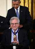 S President Barack Obama presents the Presidential Medal of Freedom to conductor Itzhak Perlman during an East Room ceremony November 24 2015 at the...