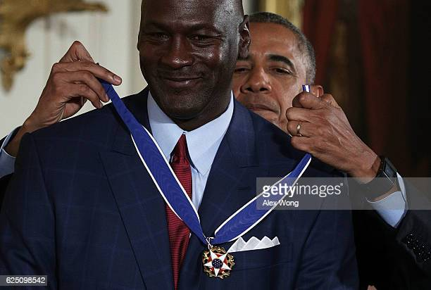 S President Barack Obama presents the Presidential Medal of Freedom to former NBA star Michael Jordan during an East Room ceremony at the White House...