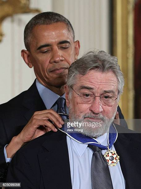 S President Barack Obama presents the Presidential Medal of Freedom to actor Robert De Niro during an East Room ceremony at the White House November...