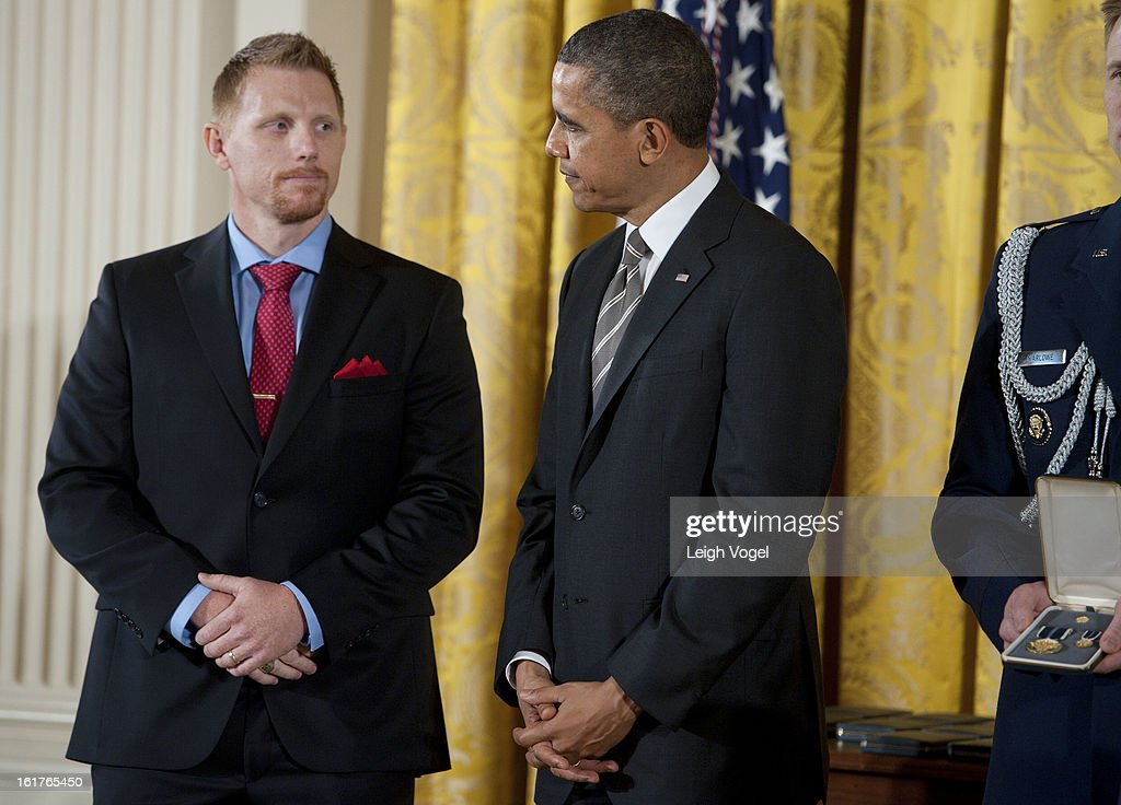 President Barack Obama presents Veterans Farm founder Adam Burke with the 2012 Presidential Citizens Medal at the White House on February 15, 2013 in Washington, DC.