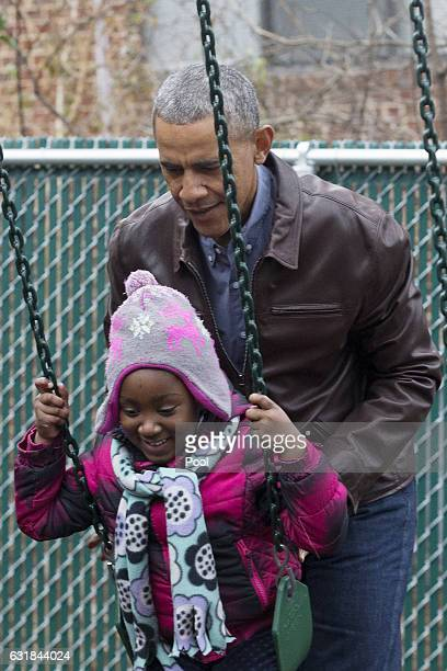 S President Barack Obama pushes children on swings on a playset dubbed Malia and Sasha's Castle formerly used by the Obama children at the White...