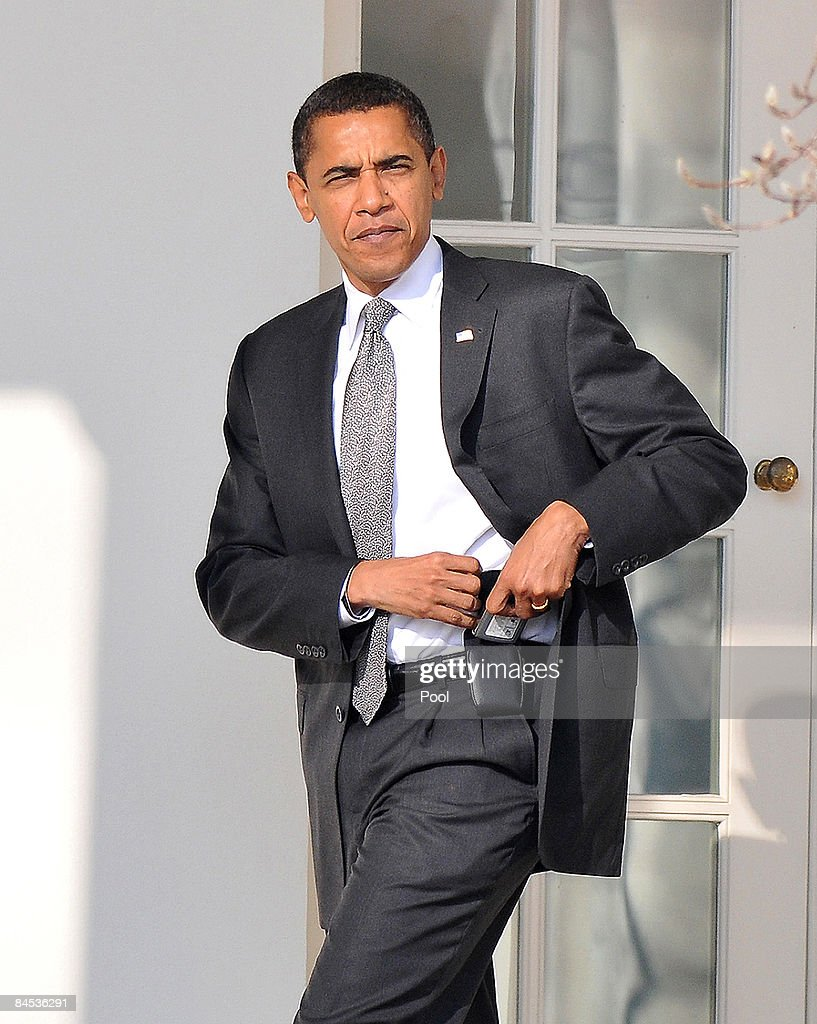 U.S. President Barack Obama puts away his Blackberry on his belt as he returns to the Oval Office at the White House January 29, 2009 in Washington, DC. Obama attended a class presentation at his daughters Sasha's school, Sidwell Friends School in Bethesda, Maryland.