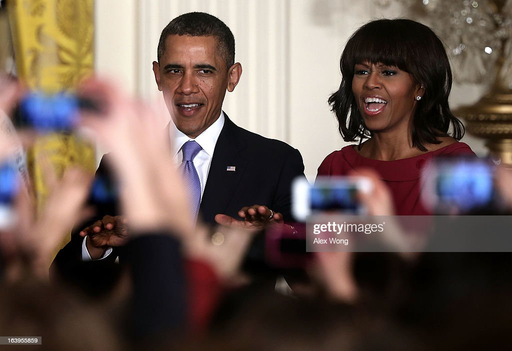 U.S. President <a gi-track='captionPersonalityLinkClicked' href=/galleries/search?phrase=Barack+Obama&family=editorial&specificpeople=203260 ng-click='$event.stopPropagation()'>Barack Obama</a> (L) quiets the crowd as first lady <a gi-track='captionPersonalityLinkClicked' href=/galleries/search?phrase=Michelle+Obama&family=editorial&specificpeople=2528864 ng-click='$event.stopPropagation()'>Michelle Obama</a> (R) cheers during a Women's History Month Reception in the East Room of the White House March 18, 2013 at the East Room of the White House in Washington, DC. President Obama has nominated Perez to succeed Hilda Solis as the next labor secretary.