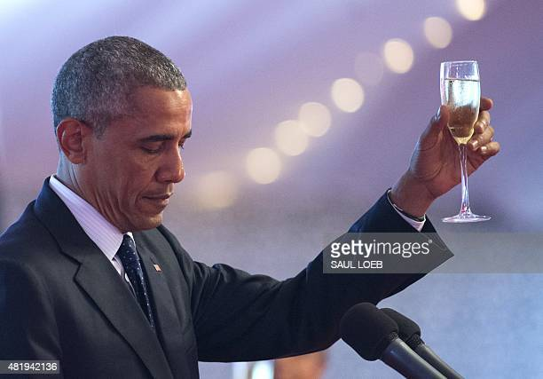 US President Barack Obama raises a toast during a State Dinner hosted by Kenyan President at the State House in Nairobi on July 25 2015 Obama arrived...