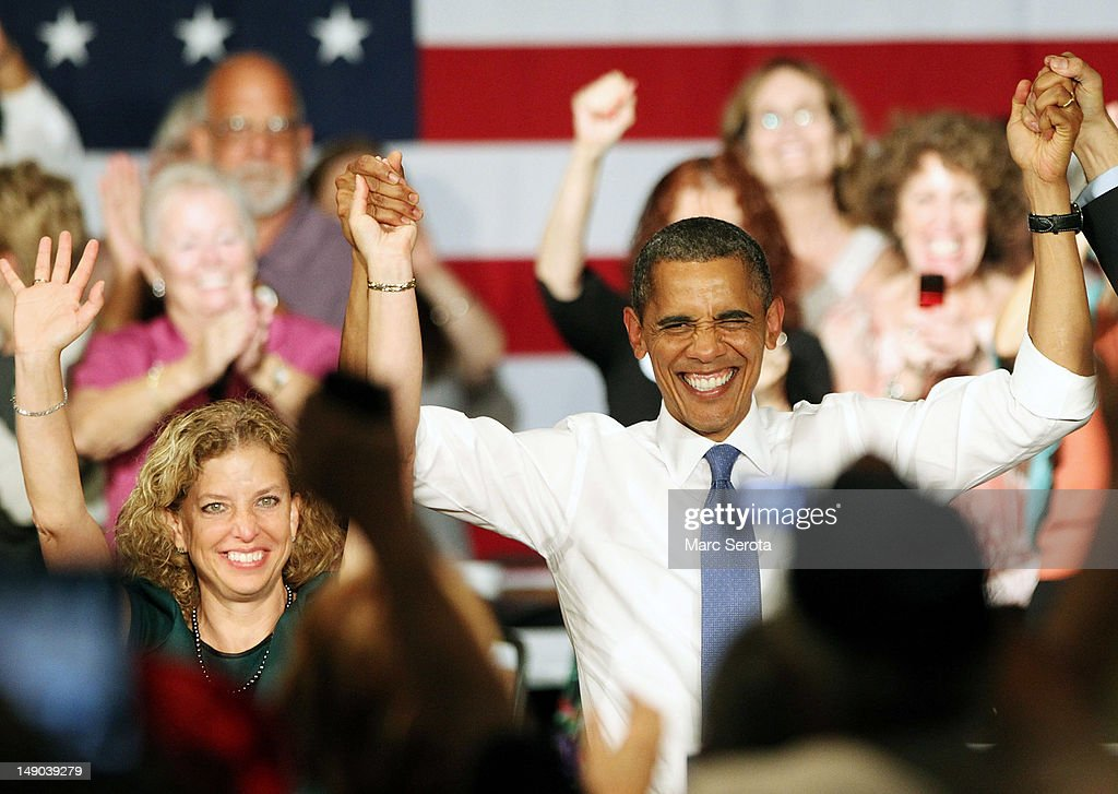 U.S. President Barack Obama raises arms with Congresswoman Debbie Wasserman Schultz (D-FL) after delivering remarks to seniors at Century Village on July 19, 2012 in West Palm Beach, Florida. Obama is campaigning for two days in Florida, a crucial swing state in November's presidential election.