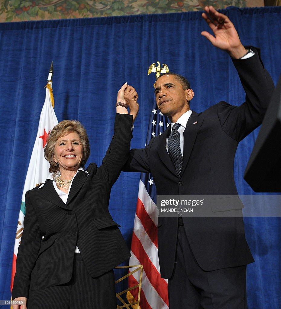 US President Barack Obama raises hands with Senator Barbara Boxer at the end of a fundraiser for Boxer (L) and the Democratic Senatorial Campaign Committee May 25, 2010 at the Fairmont Hotel in San Francisco. AFP PHOTO/Mandel NGAN