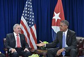 US President Barack Obama reaches out to shake hands with Cuba's President Raul Castro during a bilateral meeting on the sidelines of the United...