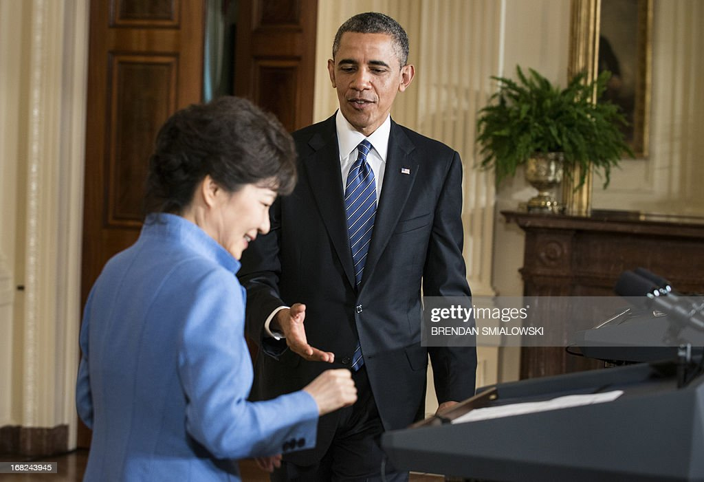 US President Barack Obama reaches to shake South Korean President Park Geun-hye's hand during a press conference in the East Room of the White House on May 7, 2013 in Washington. Obama and Park held the press conference after a meeting in the Oval Office. AFP PHOTO/Brendan SMIALOWSKI