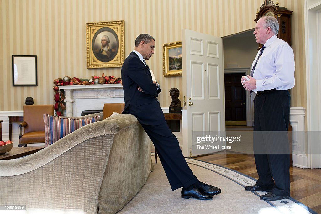 U.S. President Barack Obama reacts as John Brennan briefs him on the details of the shootings at Sandy Hook Elementary School in Newtown, Conn. on December 14, 2012 in Washington, D.C. The President later said during a TV interview that this was the worst day of his Presidency.