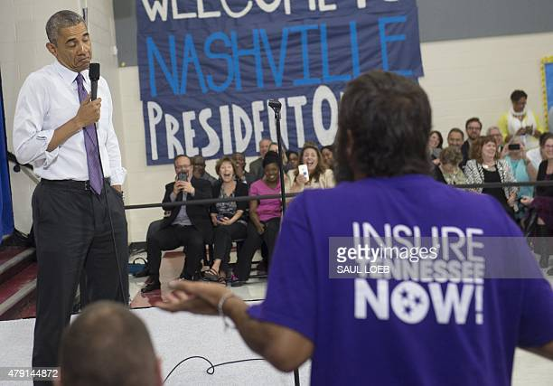 US President Barack Obama reacts to a question from a man about the Affordable Care Act known as Obamacare at Taylor Stratton Elementary School in...