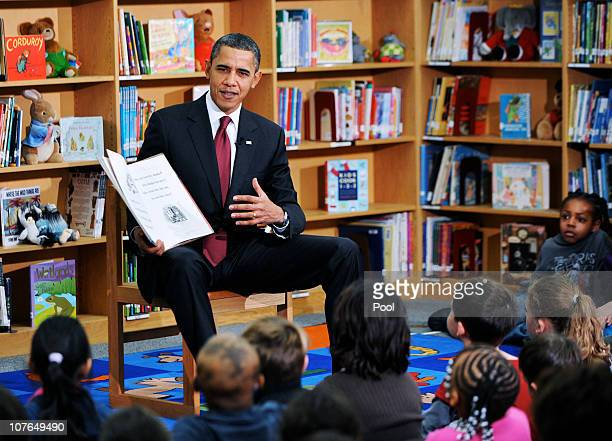 S President Barack Obama reads a book to second graders at Long Branch Elementary School December 17 2010 in Arlington Virginia Obama is expected to...