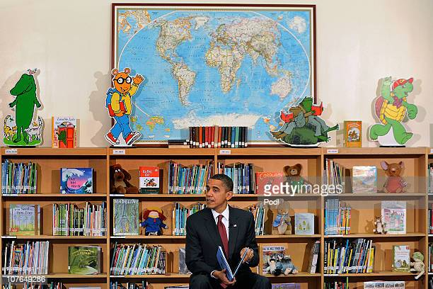 S President Barack Obama reads from his book 'Of Thee I Sing' during a reading to about 90 second graders at Long Branch Elementary School December...