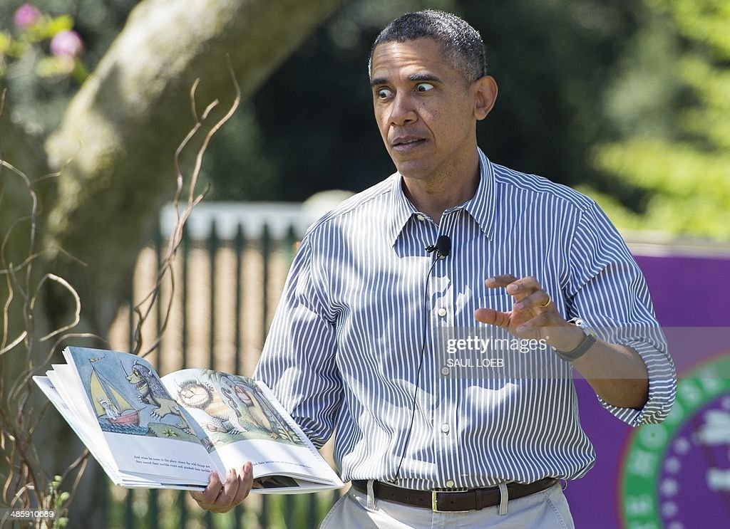 US President Barack Obama reads the book 'Where the Wild Things Are' to children attending the annual White House Easter Egg Roll on the South Lawn...