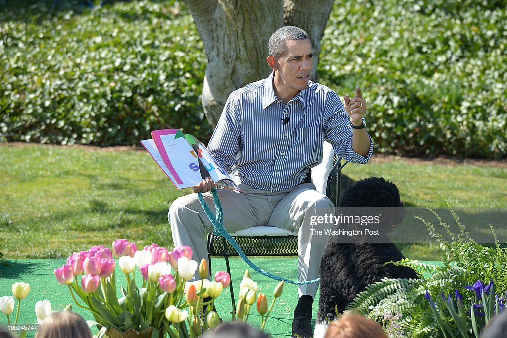 President Barack Obama reads to children from the book, 'Chicka Chicka Boom Boom' during the annual White House Easter Egg Roll on Monday April 01, 2013 in Washington, DC. Kid President, Robbie Novak was in attendance as well as Washington Wizards players and others.