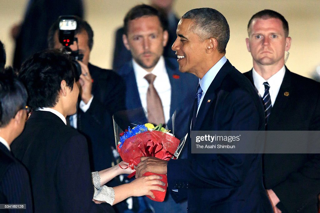 U.S. President Barack Obama receives a flower bouquet on arrival at the Centrair International Airport on May 25, 2016 in Tokoname, Aichi, Japan. The Group of Seven summit takes place on May 26 and 27 to discuss key global issues such as global economy and anti terrorism measures.