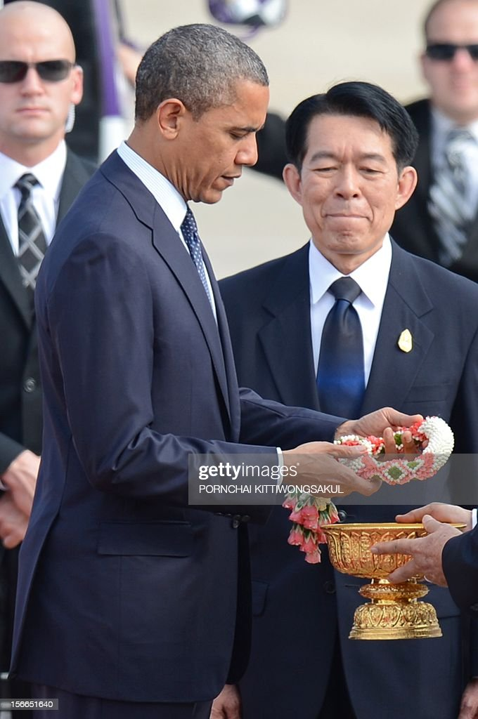 US President Barack Obama receives a garland after his arrival at Don Mueang International airport in Bangkok on November 18, 2012. Obama arrived in Bangkok on November 18 to start a three-nation tour of Southeast Asia which will include a historic visit to Myanmar.