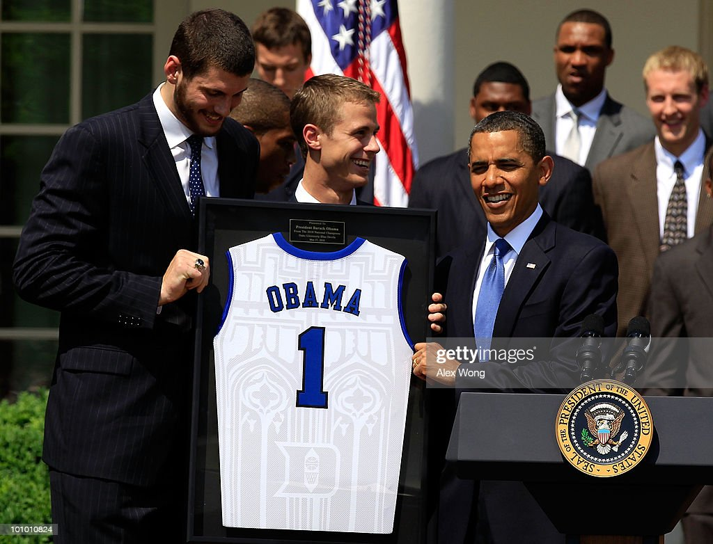U.S. President <a gi-track='captionPersonalityLinkClicked' href=/galleries/search?phrase=Barack+Obama&family=editorial&specificpeople=203260 ng-click='$event.stopPropagation()'>Barack Obama</a> (R) receives a jersey from players <a gi-track='captionPersonalityLinkClicked' href=/galleries/search?phrase=Brian+Zoubek&family=editorial&specificpeople=4091585 ng-click='$event.stopPropagation()'>Brian Zoubek</a> (L) and <a gi-track='captionPersonalityLinkClicked' href=/galleries/search?phrase=Jon+Scheyer&family=editorial&specificpeople=3847405 ng-click='$event.stopPropagation()'>Jon Scheyer</a> (2nd L) of the Duke Blue Devils during a Rose Garden event May 27, 2010 at the White House in Washington, DC. Obama hosted the NCAA men basketball champions to honor their 2009-2010 season.