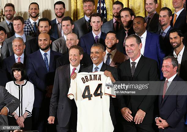 S President Barack Obama receives a San Francisco Giants jersey after welcoming the World Series Champion San Francisco Giants to the White House...
