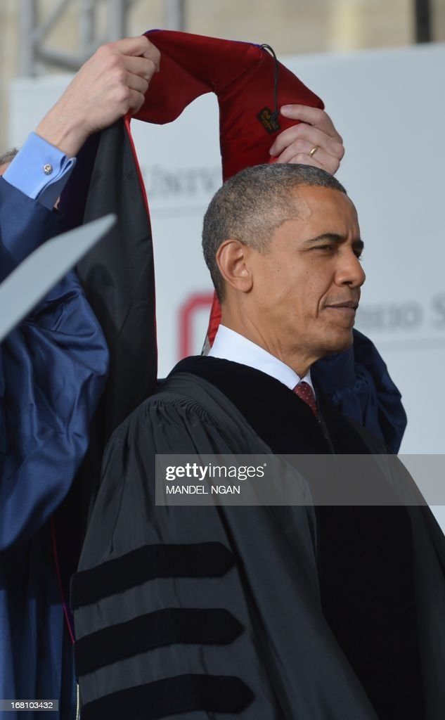 US President Barack Obama receives an honorary degree during the commencement ceremony at Ohio State University on May 5, 2013 in Columbus, Ohio. AFP PHOTO/Mandel NGAN