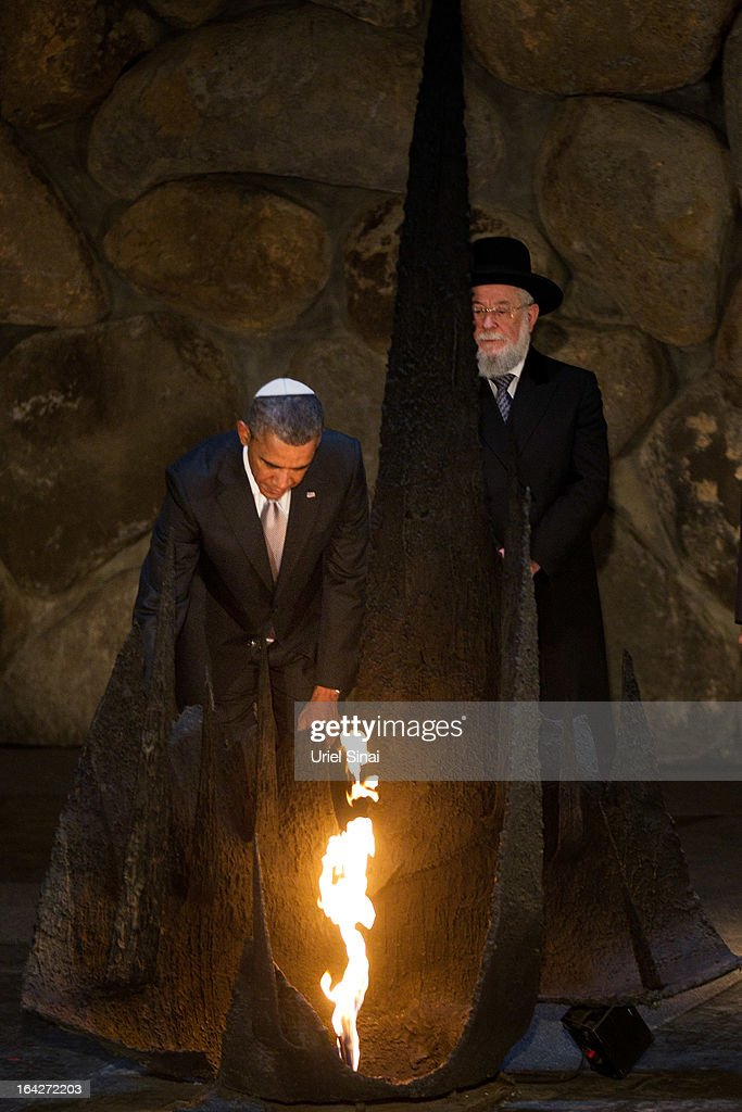 U.S. President Barack Obama rekindles the eternal flame at the Hall of Remembrance during his visit to the Yad Vashem Holocaust Memorial museum commemorating the six million Jews killed by the Nazis during World War II on March 22, 2013 in Jerusalem, Israel. This is Obama's first visit as president to the region and his itinerary includes meetings with the Palestinian and Israeli leaders as well as a visit to the Church of the Nativity in Bethlehem.