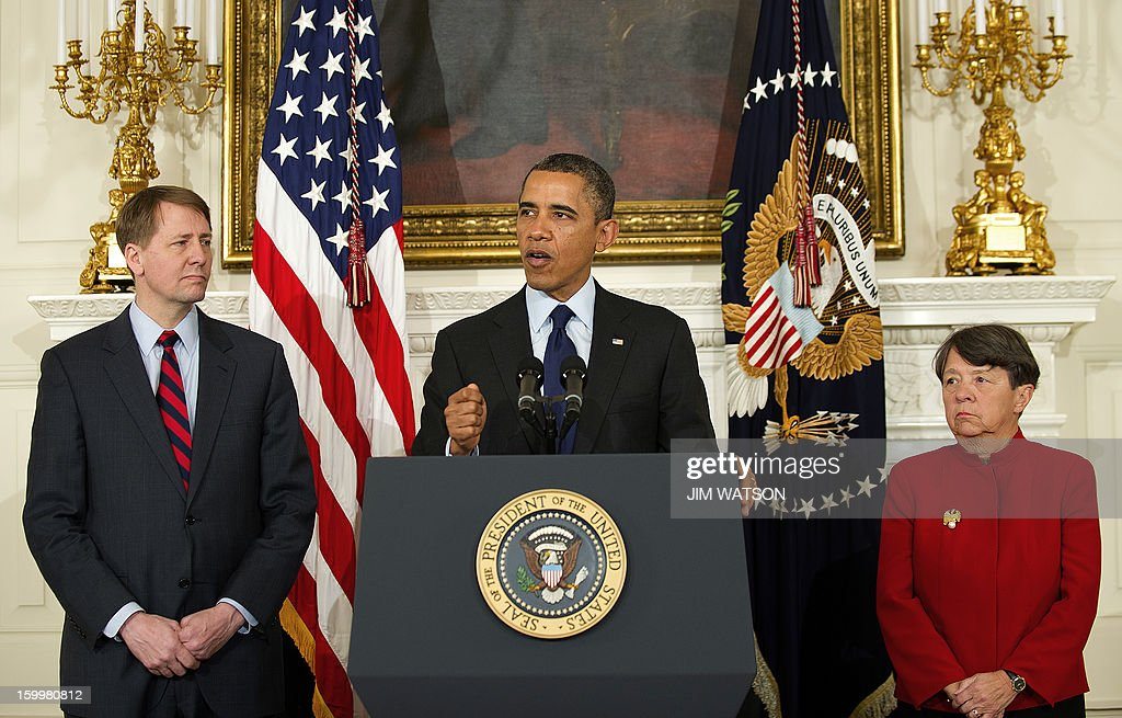 US President Barack Obama (C) renominates Richard Cordray to serve as head of the Consumer Financial Protection Bureau and Mary Jo White to lead the Securities and Exchange Commission during an event at the White House in Washington, DC, January 24, 2013. AFP PHOTO/Jim WATSON