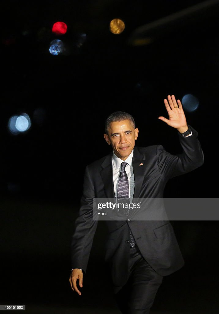 President Barack Obama returns at the White House after travelling to Los Angeles, and Phoenix Arizona, on March 13, 2015 in Washington DC,. The President traveled to the Los Angeles area where he taped an appearance on Jimmy Kimmel Live and attended a DNC event.