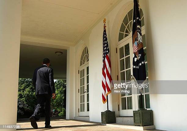S President Barack Obama returns to the Oval Office after an event of Department of Defense personnel announcements at the Rose Garden of the White...