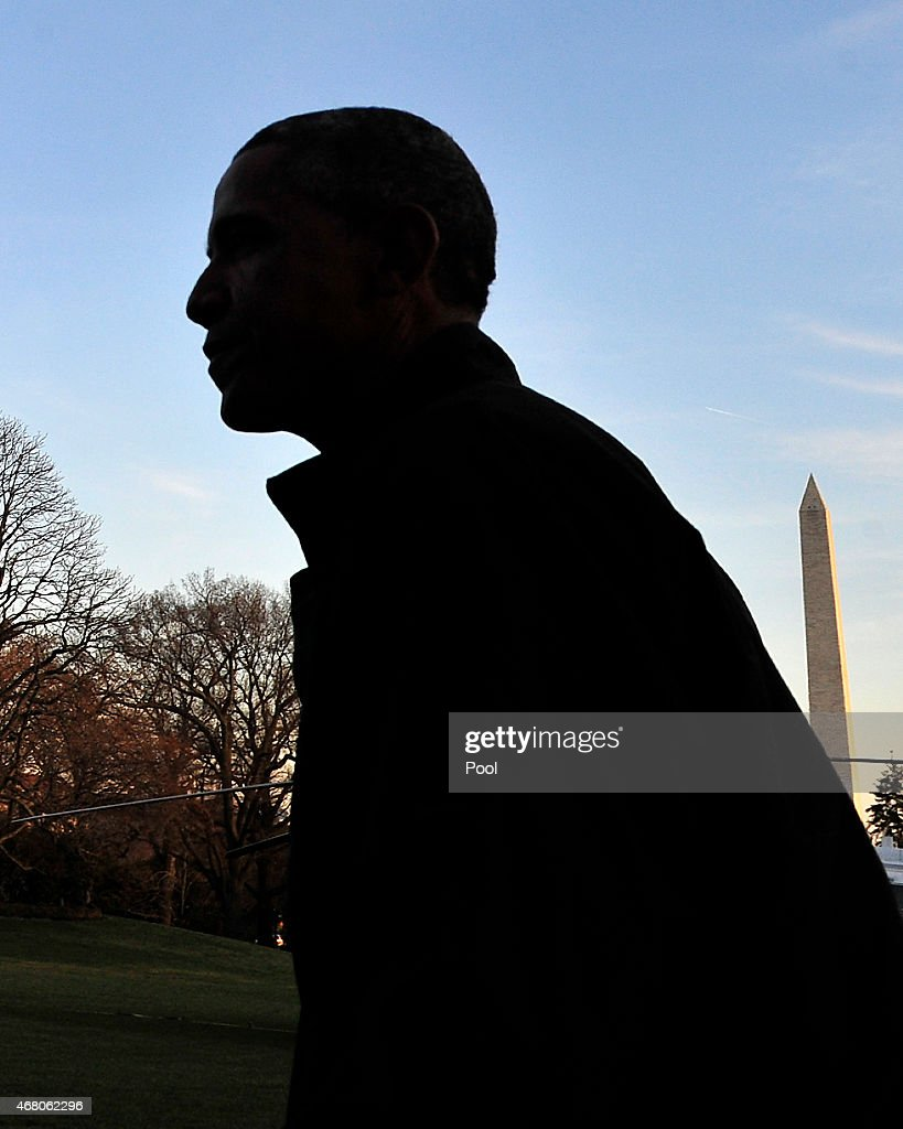 U.S. President Barack Obama returns to the White House March 29, 2015 in Washington, DC. The president was returning from a two-day trip to Palm City, Florida where he played golf. Photo by Ron Sachs-Pool via Getty Images)
