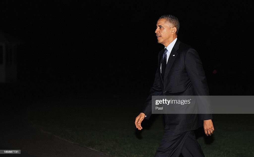 U.S. President <a gi-track='captionPersonalityLinkClicked' href=/galleries/search?phrase=Barack+Obama&family=editorial&specificpeople=203260 ng-click='$event.stopPropagation()'>Barack Obama</a> returns to the White House October 25, 2013 in Washington, DC.The President traveled to New York to attend two fund-raising events.