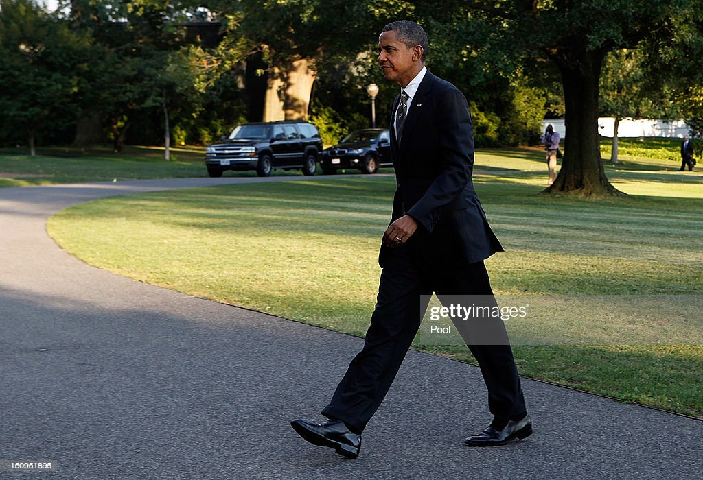 U.S. President <a gi-track='captionPersonalityLinkClicked' href=/galleries/search?phrase=Barack+Obama&family=editorial&specificpeople=203260 ng-click='$event.stopPropagation()'>Barack Obama</a> returns to the White House on August 29, 2012 in Washington, D.C. Obama continued to campaign for his re-election on the second and last day of his college tour through Iowa and Virginia.
