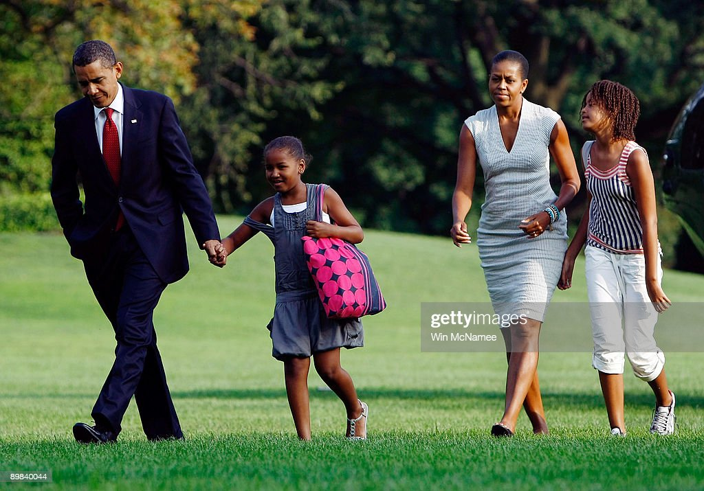 U.S. President <a gi-track='captionPersonalityLinkClicked' href=/galleries/search?phrase=Barack+Obama&family=editorial&specificpeople=203260 ng-click='$event.stopPropagation()'>Barack Obama</a> (L) returns to the White House with his family including (L-R) daughter Sasha, U.S. First Lady <a gi-track='captionPersonalityLinkClicked' href=/galleries/search?phrase=Michelle+Obama&family=editorial&specificpeople=2528864 ng-click='$event.stopPropagation()'>Michelle Obama</a>, and daughter Malia August 17, 2009 in Washington, DC. The family spent the last 3 days out of town, including a visit to the Grand Canyon National Park.