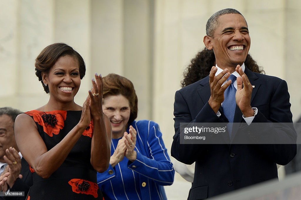U.S. President <a gi-track='captionPersonalityLinkClicked' href=/galleries/search?phrase=Barack+Obama&family=editorial&specificpeople=203260 ng-click='$event.stopPropagation()'>Barack Obama</a>, right, and First Lady <a gi-track='captionPersonalityLinkClicked' href=/galleries/search?phrase=Michelle+Obama&family=editorial&specificpeople=2528864 ng-click='$event.stopPropagation()'>Michelle Obama</a>, left, applaud during the Let Freedom Ring commemoration event at the Lincoln Memorial in Washington, D.C., U.S., on Wednesday, Aug. 28, 2013. Obama, speaking from the same Washington stage where Martin Luther King Jr. delivered a defining speech of the civil rights movement, said that even as the nation has been transformed, work remains in countering growing economic disparities. Photographer: Michael Reynolds/Pool via Bloomberg