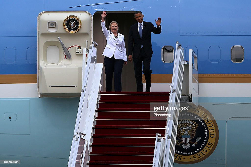U.S. President Barack Obama, right, and Hillary Clinton, U.S. secretary of state, wave as they arrive at Yangon International Airport in Yangon, Myanmar, on Monday, Nov. 19, 2012. Obama hailed Myanmar's shift to democracy and urged more steps to increase freedom in the first visit to the former military regime by a U.S. president. Photographer: Dario Pignatelli/Bloomberg via Getty Images