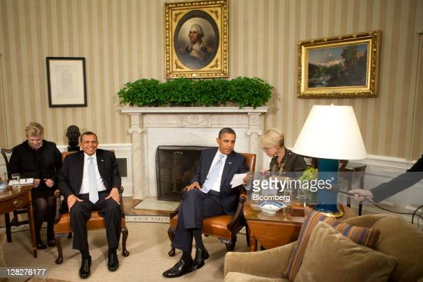US President Barack Obama right and Porfirio Lobo president of Honduras left wait with their interpreters before a meeting in the Oval Office of the...