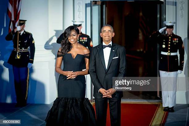 US President Barack Obama right and US First Lady Michelle Obama pose for photographs prior to greeting Xi Jinping China's president and Peng Liyuan...