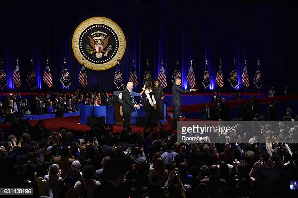 US President Barack Obama right is joined on stage by US First Lady Michelle Obama second right their daughter Malia Obama center US Vice President...