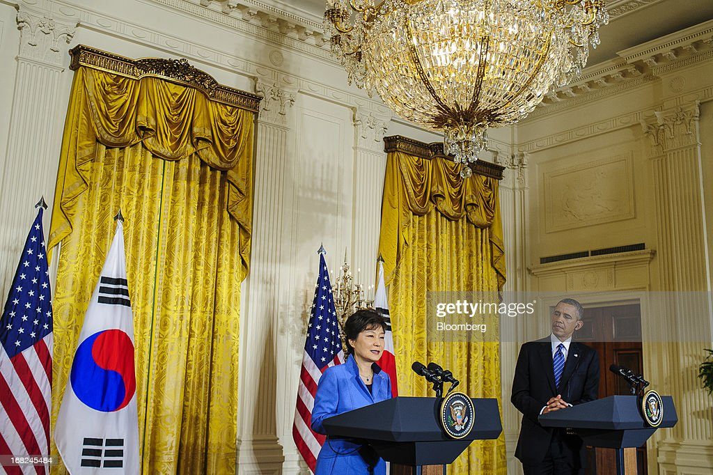 U.S. President Barack Obama, right, listens as Park Geun Hye, president of South Korea, speaks during a press conference in the East Room of the White House in Washington, D.C., U.S., on Tuesday, May 7, 2013. Obama and Park are seeking to demonstrate a solid front in the face of threats from North Korea and broader tensions in the region. Photographer: Pete Marovich/Bloomberg via Getty Images