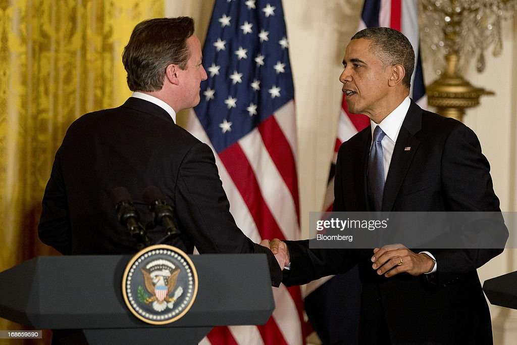 U.S. President Barack Obama, right, shakes hands with David Cameron, U.K. prime minister, during a news conference in the East Room of the White House in Washington, D.C., U.S., on Monday, May 13, 2013. President Barack Obama said his administration made no attempt to cover up or downplay the involvement of terrorists in last year's deadly attack on a U.S. outpost in Benghazi, Libya, and said the congressional investigation has turned into a 'political circus.' Photographer: Andrew Harrer/Bloomberg via Getty Images