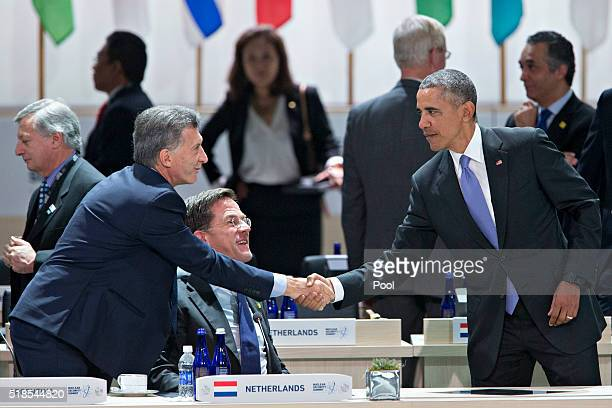 US President Barack Obama right shakes hands with Mauricio Macri Argentina's president during an opening plenary entitled 'National Actions to...