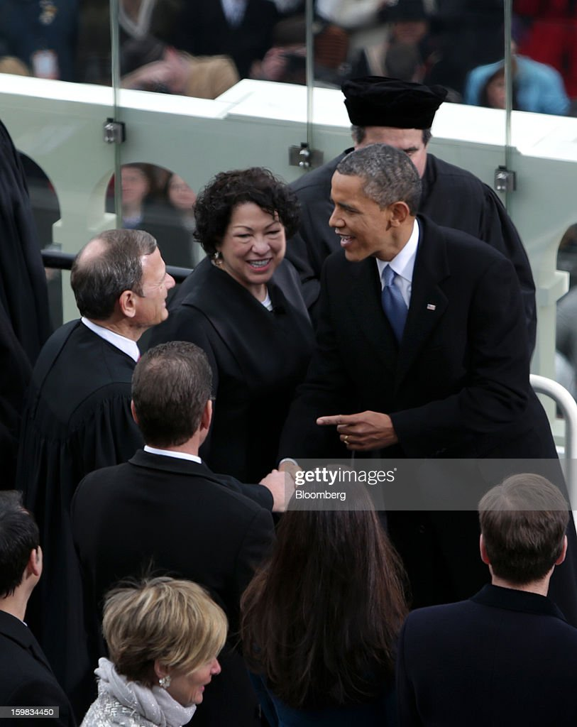 U.S. President Barack Obama, right, shakes hands with Supreme Court Chief Justice John Roberts, left, as Supreme Court Justice Sonia Sotomayor, center, smiles during the presidential inauguration in Washington, D.C., U.S., on Monday, Jan. 21, 2013. As he enters his second term, Obama has shed the aura of a hopeful consensus builder determined to break partisan gridlock and adopted a more confrontational stance with Republicans. Photographer: Scott Eells/Bloomberg via Getty Images
