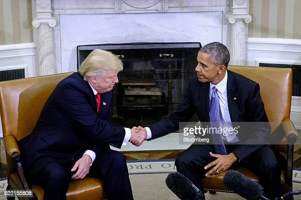 US President Barack Obama right shakes hands with US Presidentelect Donald Trump during a news conference in the Oval Office of the White House in...