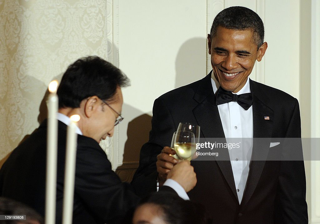 U.S. President <a gi-track='captionPersonalityLinkClicked' href=/galleries/search?phrase=Barack+Obama&family=editorial&specificpeople=203260 ng-click='$event.stopPropagation()'>Barack Obama</a>, right, shares a toast with Lee Myung-bak, president of South Korea, during a state dinner in the East Room of the White House in Washington, D.C., U.S., on Thursday, Oct. 13, 2011. Obama said the U.S. has an 'unbreakable' alliance with South Korea as he welcomed the Asian nation's president for a state visit. Photographer: Roger L. Wollenberg/Pool via Bloomberg via Getty Images