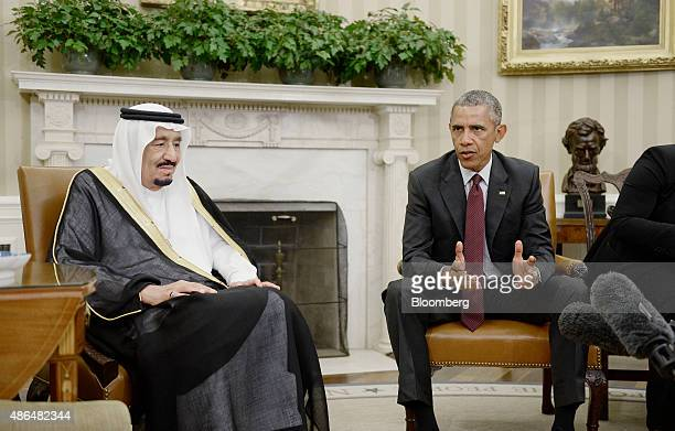 US President Barack Obama right speaks as King Salman bin Abdulaziz Al Saud of Saudi Arabia listens during a meeting in the Oval Office at the White...