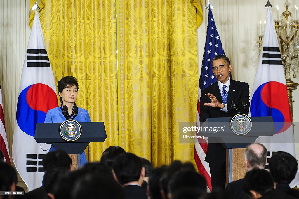 U.S. President Barack Obama, right, speaks as Park Geun Hye, president of South Korea, listens during a press conference in the East Room of the White House in Washington, D.C., U.S., on Tuesday, May 7, 2013. Obama and Park are seeking to demonstrate a solid front in the face of threats from North Korea and broader tensions in the region. Photographer: Pete Marovich/Bloomberg via Getty Images