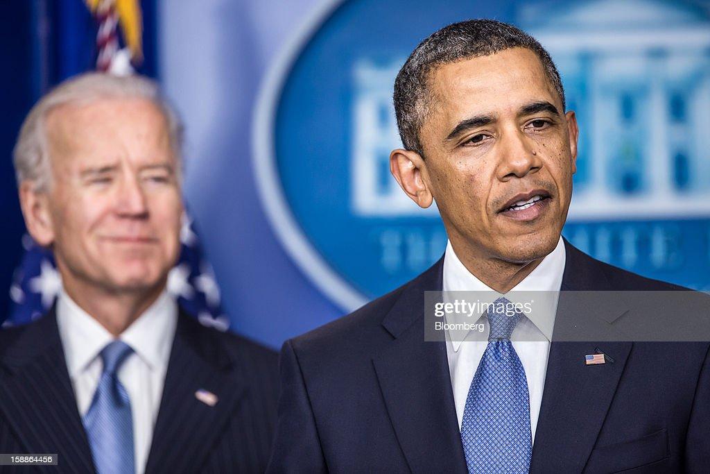 US President Barack Obama right speaks as US Vice President Joseph 'Joe' Biden looks on in the Brady Press Briefing Room at the White House in...