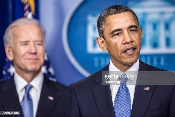 US President Barack Obama right speaks as US Vice President Joseph 'Joe' Biden looks on in the Brady Press Briefing Room at the White House in...